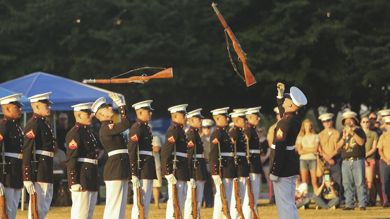 The Marine Corps Silent Drill Platoon performs during the opening ceremony of Marine Week Nashville in Nashville, Tenn., Sept. 7, 2016. Marine Week provides an opportunity for the Marine Corps to visit a city that normally doesn't have opportunities to interact with Marines on a regular basis.
