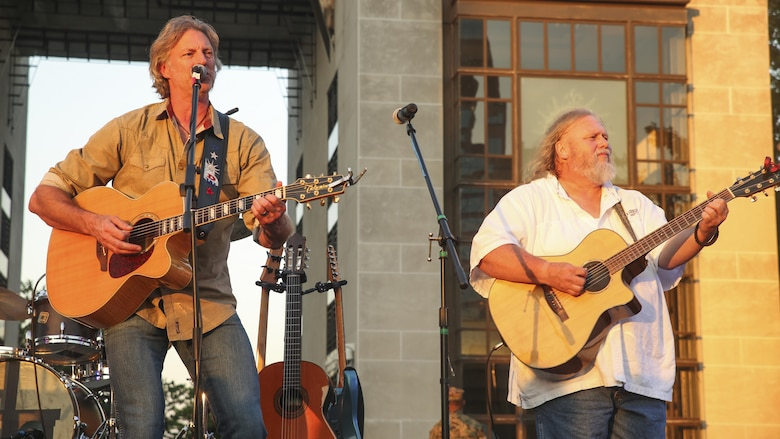 Darryl Worley, left, a country music artist, performs for Marines and Nashville, Tenn. residents during the opening ceremony of Marine Week Nashville, Sept. 7, 2016. Marine Week is an opportunity to commemorate the unwavering support of the American people, and show the Marine Corps' dedication to protecting citizens of this country.