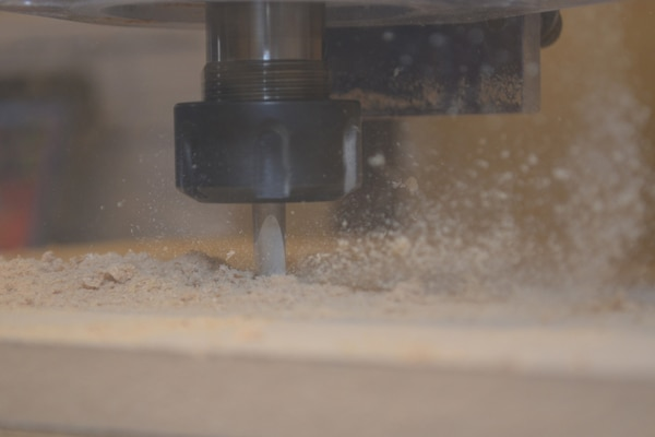The precision 3-Dimensional CNC Router cuts through wood inside SERMC's Fabrication Laboratory, or Fab Lab. DARPA, who supplied the Fab Lab, designed it so Sailors at SERMC will convert innovative ideas into designes and rapid prototypes which could be used fleet-wide.