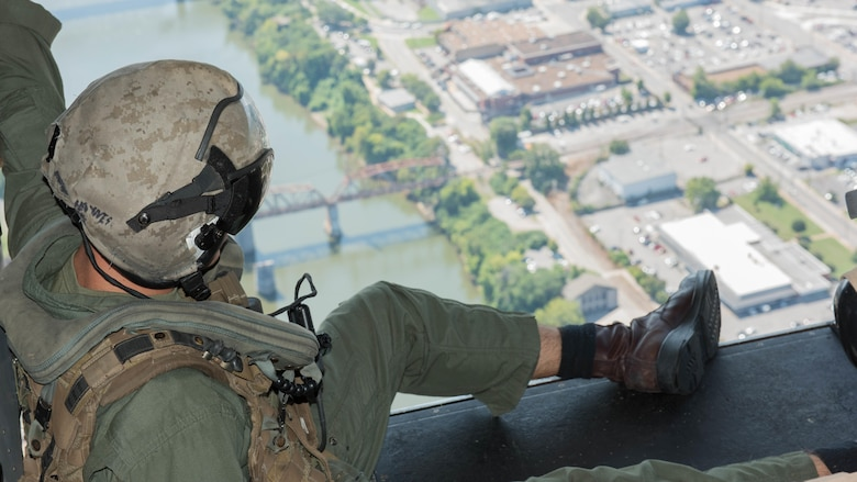 Cpl. Joshua Haynes a crewmember with Marine Medium Tiltrotor Squadron 261 supervises the passengers during the MV-22B Osprey flights over Nashville, Tenn., Sept. 7, 2016 as part of Marine Week.  Marine Week provides an opportunity for the Marine Corps to visit cities that normally don't have the opportunity to interact with Marines on a regular basis.