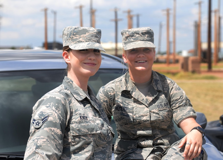 Airman 1st Class Haleigh Knox and Airman 1st Class Hailey Salyers, 82nd Medical Operations Squadron mental health technicians, were driving to a coworker's wedding when a truck ahead of them swerved, overcorrected and drove into the median and began flipping. The two Airmen sprung into action, using self-aid buddy care techniques to aid the injured driver until paramedics arrived. (U.S. Air Force photo by Senior Airman Robert L. McIlrath)