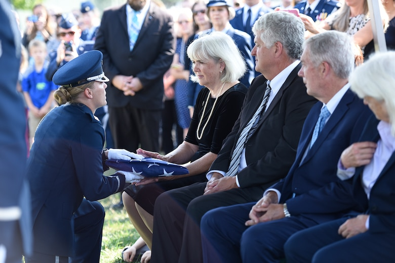 Terry Harmon, the daughter of Women Airforce Service Pilot 2nd Lt. Elaine Harmon, receives the American flag from a member of the U.S. Air Force Honor Guard during her late-mother's interment ceremony at Alrington National Cemetery, Va., Sept. 7, 2016. Harmon died in 2015 at the age of 95. (U.S. Air Force photo/Staff Sgt. Alyssa C. Gibson)