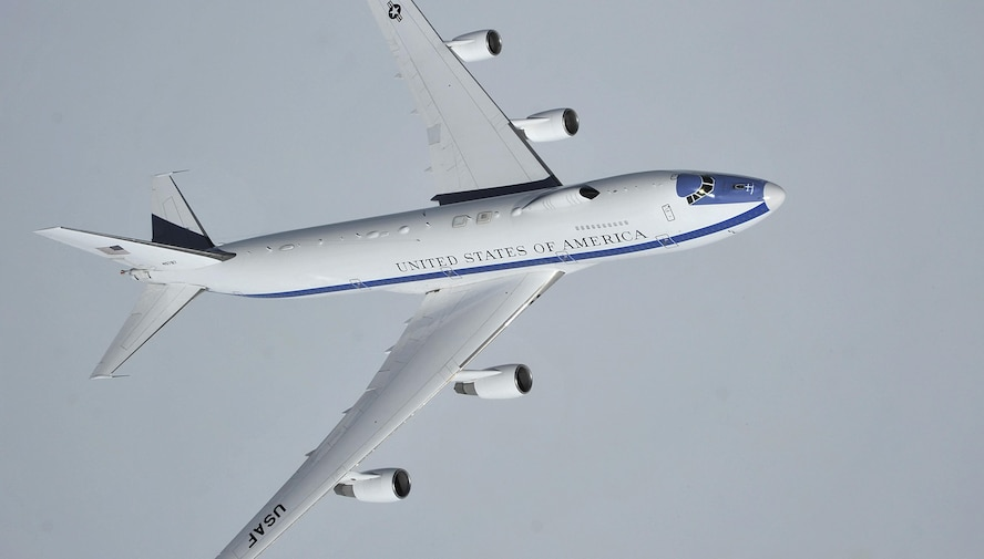 An Air Force E-4B flies over the Canadian Pacific coast, Wash., April 10, 2014. Air Combat Command is the Air Force single-resource manager for the E-4B, and provides aircrew, maintenance, security and communications support. E-4B operations are directed by the Joint Chiefs of Staff and executed through U.S. Strategic Command. (U.S. Air Force photo by Senior Airman Mary O'Dell)