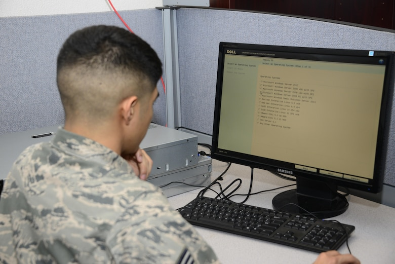 U.S. Air Force Senior Airman David Cruz, 355th Communications Squadron network operations technician, installs Windows Server 2008 on a print server at Davis-Monthan Air Force Base, Ariz., Sept. 7, 2016. The network operations team keeps base systems compliant with the standards of the Defense Information Systems Agency by using software, hardware and scripting solutions. (U.S. Air Force photo by Senior Airman Betty R. Chevalier)