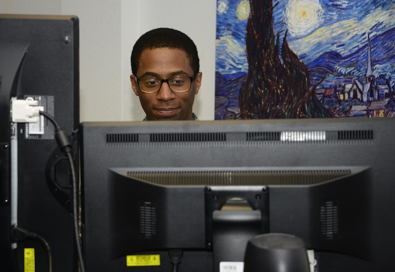 U.S. Air Force Staff Sgt. Marcus Jackson, 355th Communications Squadron network operations technician, runs a network security scan at Davis-Monthan Air Force Base, Ariz., Sept. 7, 2016. The network operations team is responsible for upgrading and ensuring all systems are compliant with the standards of the Defense Information Systems Agency by using software, hardware and scripting solutions. (U.S. Air Force photo by Senior Airman Betty R. Chevalier)