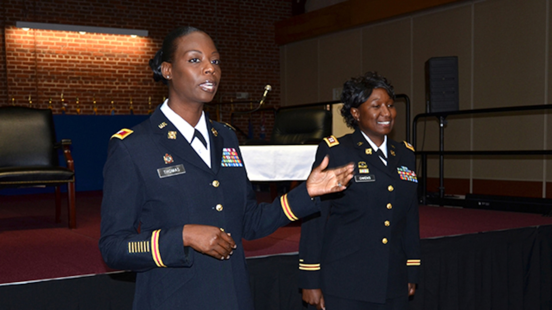 During the Women's Equality Day celebration on Defense Supply Center Richmond, Virginia, Aug. 31, 2016, Defense Logistics Agency Aviation's Army Col. Kim Thomas, deputy director for Strategic Acquisition Programs Directorate conducts a promotion ceremony for DLA Army Reserve Capt. Delecia Owens to Major. Owens is a contract specialist in Supplier Operations Commodities Directorate.