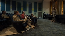 Lt. Col. Mike Freeman, 99 Civil Engineering Squadron Commander, explains the changes made to utility allowance to Airmen that attended a town hall meeting at the Nellis Base Theater, Aug. 30, 2016. Freeman then outlined how the old system and the new system will be different for the residents of base housing and how the new system will serve multiple purposes. (U.S. Air Force photo by Airman 1st Class Kevin Tanenbaum/Released)