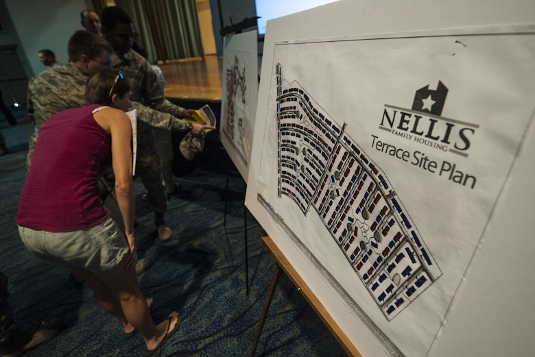 Airmen and spouses that attended a town hall meeting discussing the changes in utility allowance view a map of base housing at the Nellis Base Theater, Aug. 30, 2016. Col. Zev York, 99th Air Base Wing Vice Commander, and Lt. Col. Mike Freeman, 99th Civil Engineering Squadron Commander took time to explain in detail the changes will be occurring to base resident's utility allowance. (U.S. Air Force photo By Airman 1st Class Kevin Tanenbaum/Released)