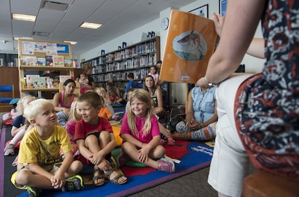 "Katie Loveless, 11th Force Support Squadron senior library technician, reads ""Pirates Love Underpants"" to a group of children during story time at the library on Joint Base Andrews, Md., Aug. 31, 2016. Story time is held every Monday at 5:30 p.m. and every Wednesday at 10:30 a.m. (U.S. Air Force photo by Airman 1st Class Philip Bryant)"