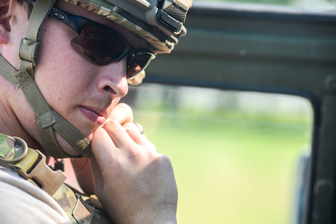Senior Airman Tyler Squibb, 788th Civil Engineer Squadron, explosive ordinance disposal technician, snaps his helmet chin strap in preparation of performing reconnaissance during an unexploded ordinance scenario as part of an exercise, at Wright-Patterson Air Force Base, Ohio August 2, 2016. As part of the scenario the EOD team had to identify and dispose of the explosive device in the proper manner. (U.S. Air Force photo / Wesley Farnsworth)