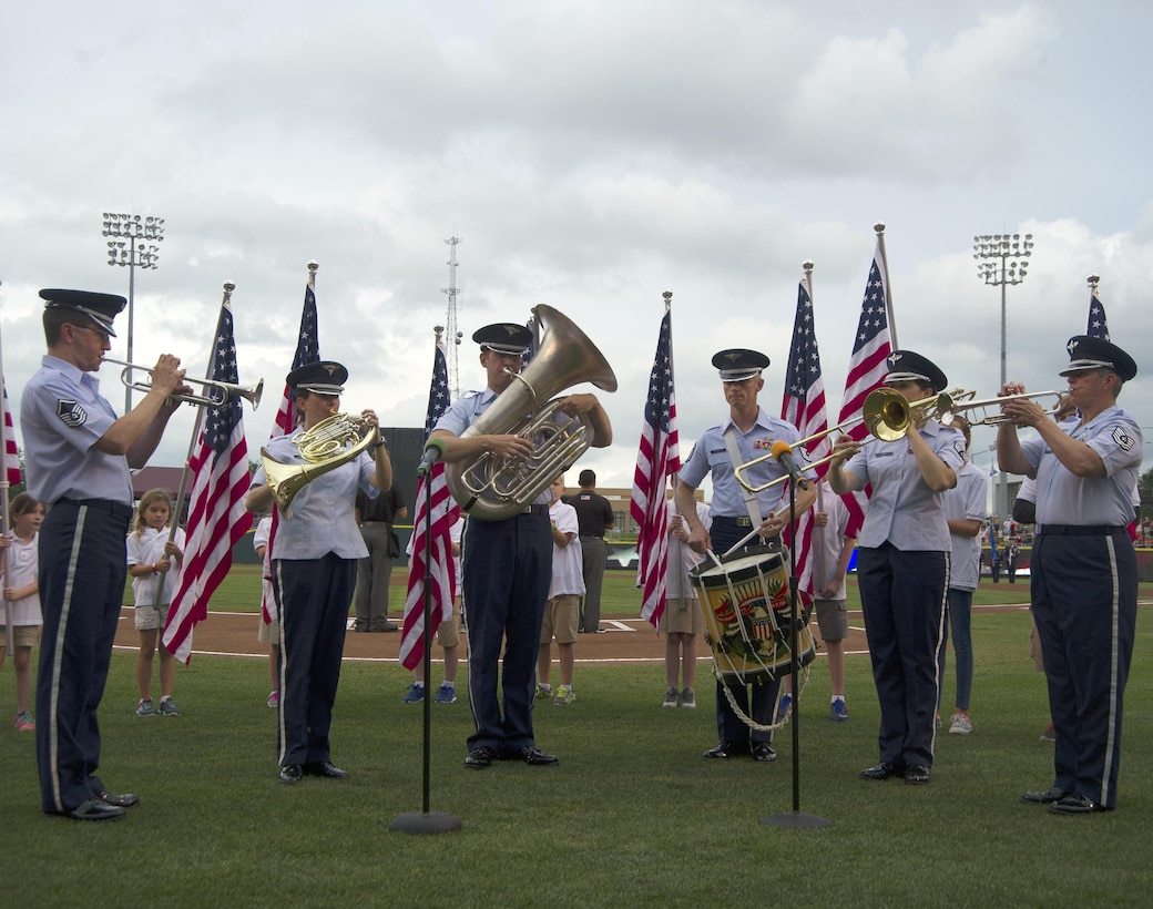 Members of the U.S. Air Force Band of Flight from Wright-Patterson Air Force Base perform the national anthem at the start of a Dayton Dragons baseball game, August 13, 2016. The band performed as part of the military appreciation night festivities held by the Dragons. (U.S Air Force photo / R.J. Oriez)