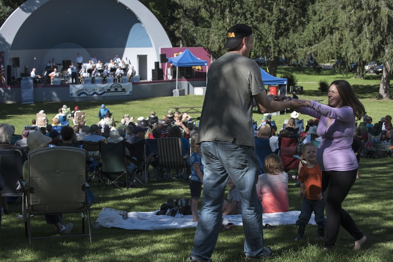 Audience members dance during a U.S. Air Force Band's Airmen of Note concert in Victory Park Band Shell at Albion, Mich., Sept. 3, 2016. The Airmen of Note, U.S. Air Force Band's premier jazz ensemble, toured from Naperville, Ill., to Detroit, Mich., during the Labor Day weekend. (U.S. Air Force photo by Senior Airman Philip Bryant)