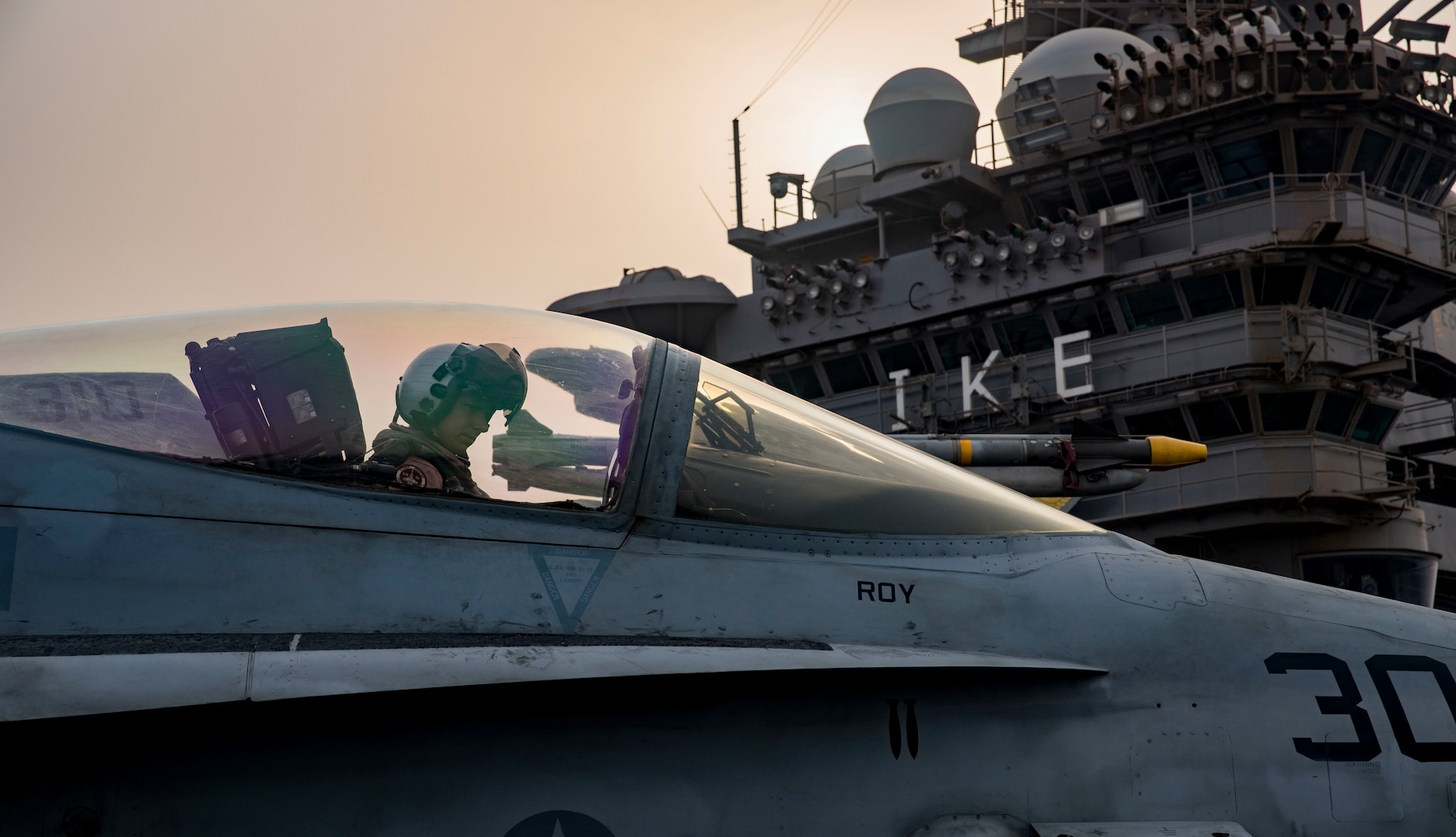 A Navy pilot assigned to Strike Fighter Squadron 131 taxies an F/A-18C Hornet on the flight deck of the aircraft carrier USS Dwight D. Eisenhower at sea in the Persian Gulf, Sept. 9, 2016. The Eisenhower and its carrier strike group are deployed in support of Operation Inherent Resolve, maritime security operations and theater security cooperation efforts in the U.S. 5th Fleet area of operations. Navy photo by Petty Officer 3rd Class Nathan T. Beard