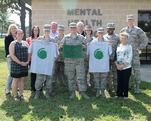 The Mental Health Flight stands in front the Mental Health Clinic at Tyndall Air Force Base, Fla., Sept. 7, 2016. The Mental Health Flight promotes both the Green Dot Program and the message of coming forward when you are suffering from mental stress or depression. (U.S. Air Force photo by Airman 1st Class Cody R. Miller/Released)