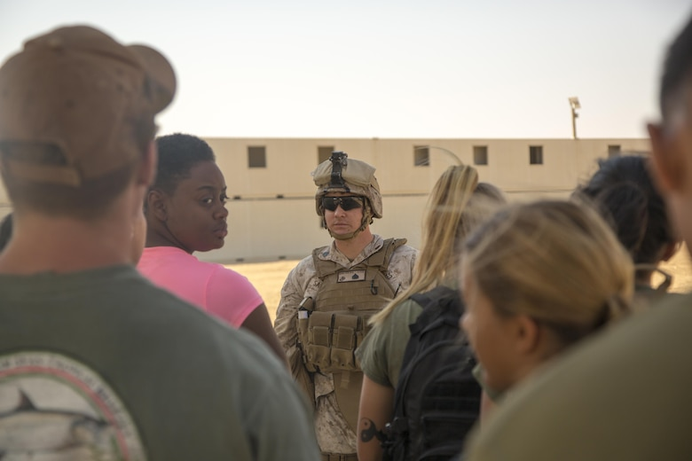 Sgt. Blake G. Sanches, embark clerk, Special Purpose Marine Air Ground Task Force, Crisis Response, Central Command, guides role-players to a notional evacuation site during a non-combatant evacuation operation exercise at Range 220, a military operations on urbanized terrain facility, aboard the Marine Corps Air Ground Combat Center, Twentynine Palms, Calif., Aug. 24, 2016, as part of a Certification Exercise. (Official Marine Corps photo by Lance Cpl. Levi Schultz/Released)