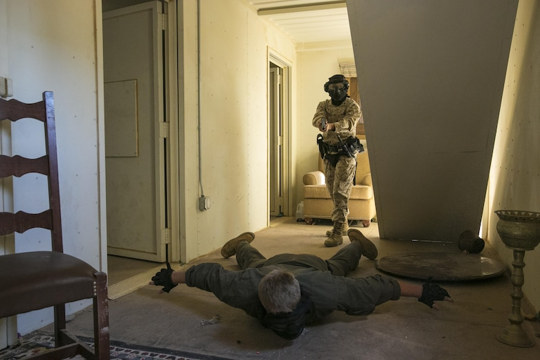 Lance Cpl. Bernice Hernandez, military police officer, Provost Marshal's Office commands a roleplayer during a domestic disturbance simulation at Range 800 aboard Marine Corps Air Ground Combat Center, Twentynine Palms, Calif., Aug. 30, 2016. PMO uses these drills to prepare for scenarios they could potentially encounter while out on patrol. (Official Marine Corps photo by Lance Cpl. Dave Flores/Released)