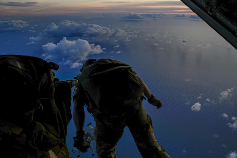 A 320th Special Tactics Squadron member, jumps from an MC-130J Commando II from the 17th Special Operations Squadron during an airfield seizure exercise Aug. 24, at Wake Island. The realistic training of the operations conducted allowed the units to address any issues before taking on any real world tasking. (U.S. Air Force photo by Senior Airmen Stephen G. Eigel)