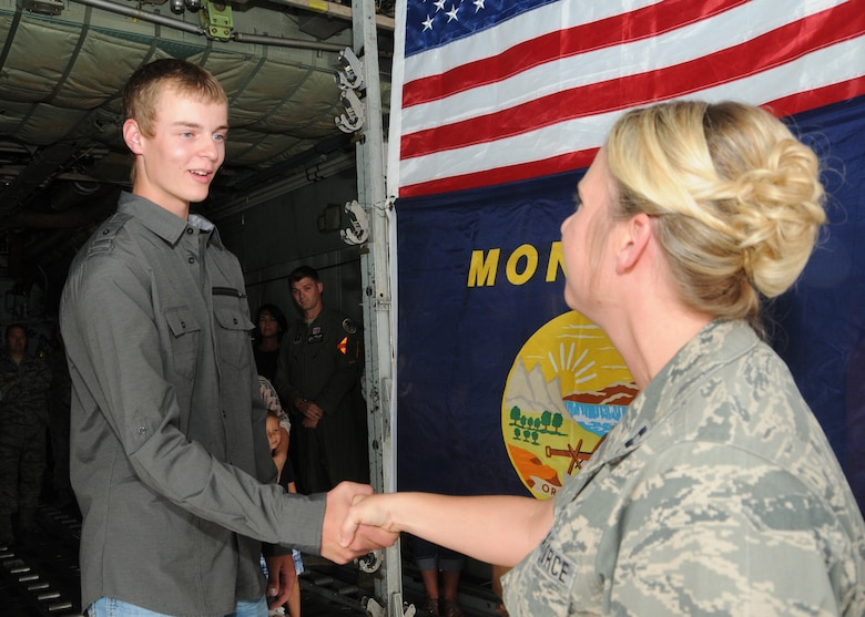 Tyler LaPierre is congratulated by Capt. Jennifer LaPierre Gunter following his Montana Air National Guard enlistment in the cargo hold of a C-130 Hercules transport aircraft parked at the 120th Airlift Wing in Great Falls, Mont. Aug. 31, 2016. Gunter administered LaPierre's oath of enlistment. (U.S. Air National Guard photo by Senior Master Sgt. Eric Peterson)