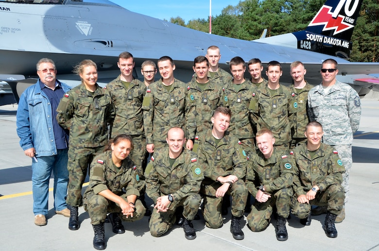 Lask Air Base, Poland - Polish maintenance officer cadets stand in front of a 114th Fighter Wing F-16 Fighting Falcon here, Sept. 6. The cadets had the opportunity to visit with 114th Maintenance Group personnel and learn about the similarities and differences between the 114th MXG and Polish maintenance. (U.S. Air National Guard photo by Capt. Amy Rittberger/Released)
