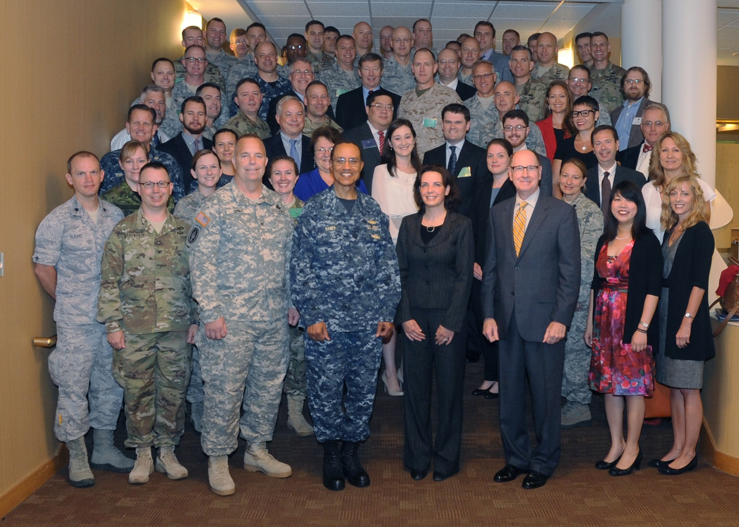 Adm. Cecil D. Haney (front row, center left), U.S. Strategic Command (USSTRATCOM) commander; Jennifer M. O'Connor (front row, center right), general counsel of the Department of Defense (DoD); retired Air Force Gen. C. Robert Kehler (front row, third from right), former USSTRATCOM commander; and Col. Michael L. Smidt (front row, third from left), USSTRATCOM staff judge advocate; stand with attendees of the inaugural USSTRATCOM-hosted Advanced Operations Law Conference at the Dougherty Conference Center, Offutt Air Force Base, Neb., Sept. 8, 2016. The three-day conference, held in collaboration with the National Strategic Research Institute and the University of Nebraska College of Law, brought together USSTRATCOM leadership, attorneys from government organizations and academia, and other legal experts to better understand operational law and share thought processes across organizational lines. Topics of discussion included economic targeting, foreign approach to the law of armed conflict, and critical issues in space and cyber law and policy. One of nine DoD unified combatant commands, USSTRATCOM has global strategic missions assigned through the Unified Command Plan, which include strategic deterrence; space operations; cyberspace operations; joint electronic warfare; global strike; missile defense; intelligence, surveillance and reconnaissance; combating weapons of mass destruction; and analysis and targeting. (DoD photo by Steve Cunningham)