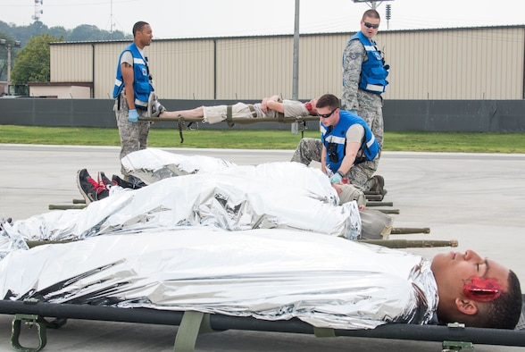 U.S. Airmen from the 51st Medical Group line up simulated injured individuals during an emergency management exercise at Osan Air Base, Republic of Korea, Sept. 8, 2016. Airmen from the 51st Fighter Wing practiced emergency management procedures in case of situations with downed aircraft. (U.S. Air Force photo by Senior Airman Dillian Bamman)