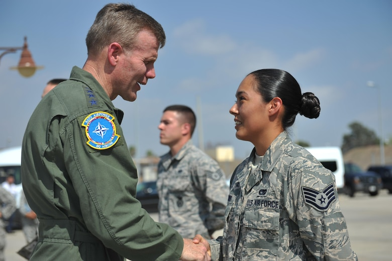 U.S. Air Force Gen. Tod D. Wolters, U.S. Air Forces in Europe and U.S. Air Forces Africa commander, speaks to Staff Sgt. Amanda Olmos from the 39th Logistics Readiness Squadron Aug. 31, 2016, at Incirlik Air Base, Turkey. Wolters spent the day interacting with Airmen as he learned about and observed them performing their duties. (U.S. Air Force photo by Tech. Sgt. Joshua T. Jasper)