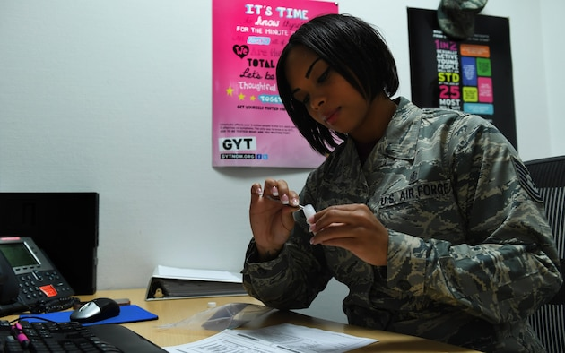 Tech. Sgt. Jessica Roofe, 86th Aerospace Medicine Squadron NCO in charge of epidemiology, prepares a tick to be sent for testing Sept. 9, 2016 at Ramstein Air Base, Germany. Ticks brought to the office by Kaiserslautern Military Community members are tested for Lyme disease. (U.S. Air Force photo/Senior Airman Tryphena Mayhugh)