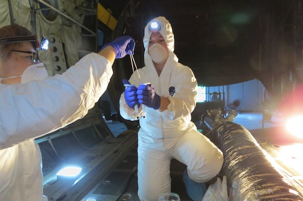 AFRL Biological Materials and Processing Research Team members perform sample tests of various aircraft locations at the conclusion of the Joint Biological Agent Decontamination System process.  (U.S. Air Force photo)
