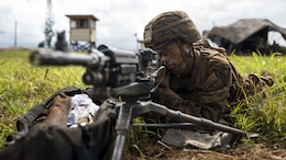 "Pfc. Jeremiah Overton, an artilleryman with Bravo Company, ""Black Sheep,"" 1st Battalion, 12th Marine Regiment, and a Loraine, Ohio, native, provides security with his M240 Machine Gun for M777 Light Weight Towed Howitzers and their artillerymen during a training exercise at Marine Corps Base Hawaii, Sept. 06, 2016. Marines from Bravo Co., ""Black Sheep,"" 1st Bn., 12th Marines, participated in exercise Spartan Fury 16.4. Spartan Fury is a pre-deployment exercise in which service members conduct live-fire artillery training and unit leaders are able to further assess and improve the lethality of the battalion."