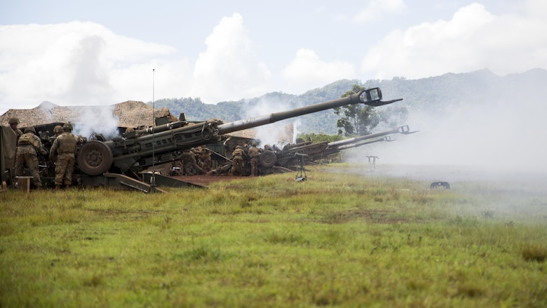 "Marines from Bravo Company, ""Black Sheep,"" 1st Battalion, 12th Marine Regiment, fire off artillery rounds from their M777 Light Weight Towed Howitzer during a training exercise at Marine Corps Base Hawaii, Sept. 06, 2016. Marines from Bravo Co., ""Black Sheep,"" 1st Bn., 12th Marines, participated in exercise Spartan Fury 16.4. Spartan Fury is a pre-deployment exercise in which service members conduct live-fire artillery training and unit leaders are able to further assess and improve the lethality of the battalion."