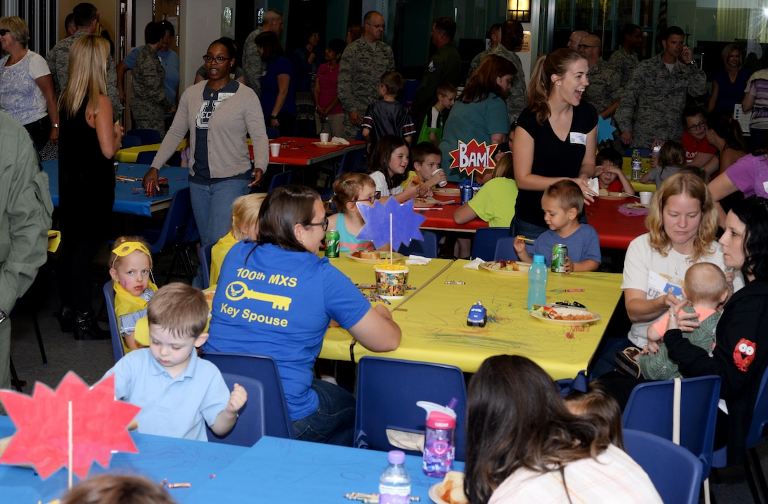 Team Mildenhall Airmen, spouses and children socialize at a Hearts Apart event Sept. 8, 2016, on RAF Mildenhall. The monthly Hearts Apart dinners are a way for spouses and family members of deployed Airmen to gather together and connect. (U.S. Air Force photo by Airman 1st Class Tenley Long)