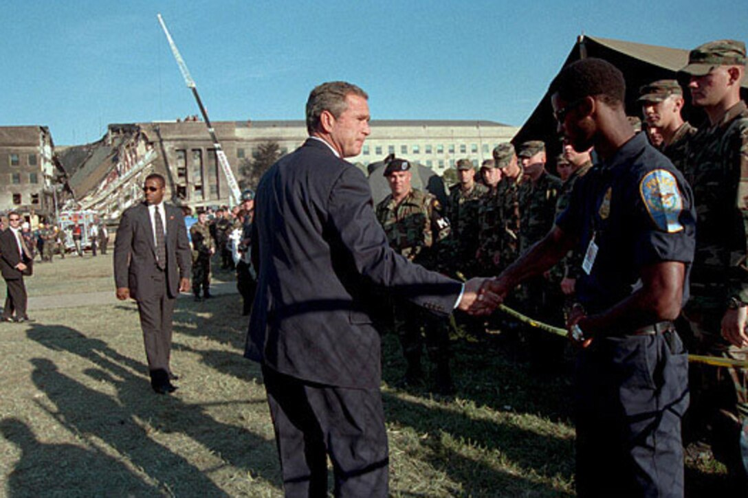 President George W. Bush thanks a first responder for his service outside the Pentagon on Sept. 12, 2001.