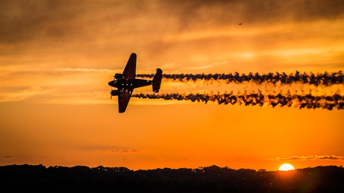 A Beechcraft twin-engine aircraft performs a routine at sunset during the Sound of Speed Air Show above the Rosecrans Memorial Airport in St. Joseph, Mo., Aug. 26, 2016. The air show was hosted by the Missouri Air National Guard's 139th Airlift Wing to thank the surrounding community for its support. (U.S. Air Force photo/Senior Airman Patrick P. Evenson)