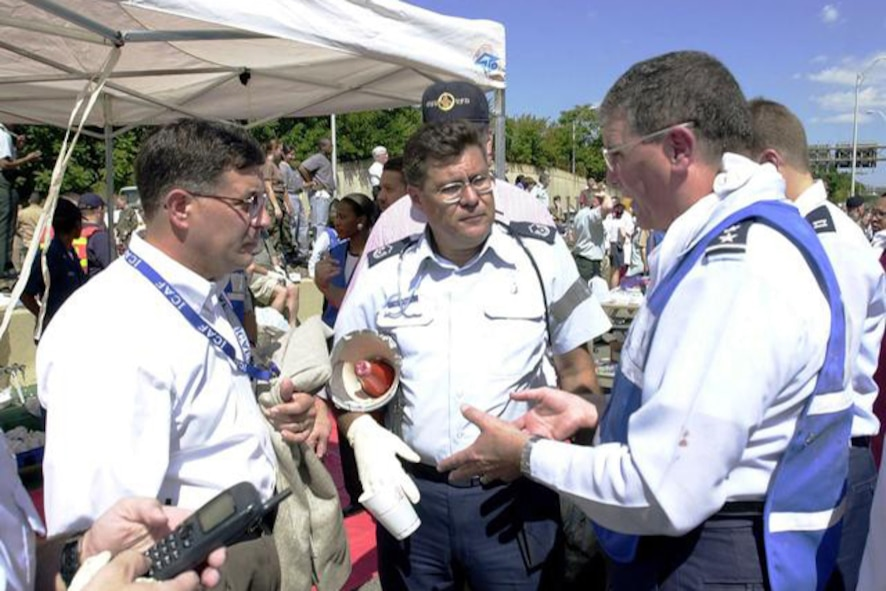 Lt. Gen.l (Dr.) Paul Carlton Jr., surgeon general of the Air Force, right, Master Sgt. Noel Sepulveda, center, and Pentagon employees pitch in to help where needed.