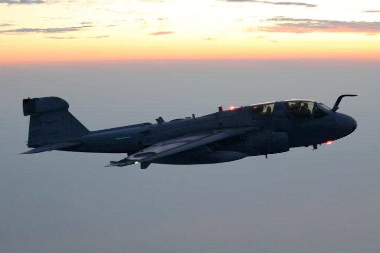 An EA-6B Prowler soars through the evening sky during an aerial refueling mission over the Atlantic Ocean Sept. 7, 2016. The mission of Marine Aerial Refueler Transport Squadron 252 is to support the Marine Air Ground Task Force commander by providing air-to-air refueling, assault support, and offensive air support, day or night under all weather conditions during expeditionary, joint, or combined operations.  VMGR-252 conducted aerial refuels for AV-8B Prowlers, EA-6B Harriers, and F-35B Lightnings off the coast of North Carolina to provide routine training for both the pilots and crew members. (U.S. Marine Corps Photo by Lance Cpl. Mackenzie Gibson/Released)