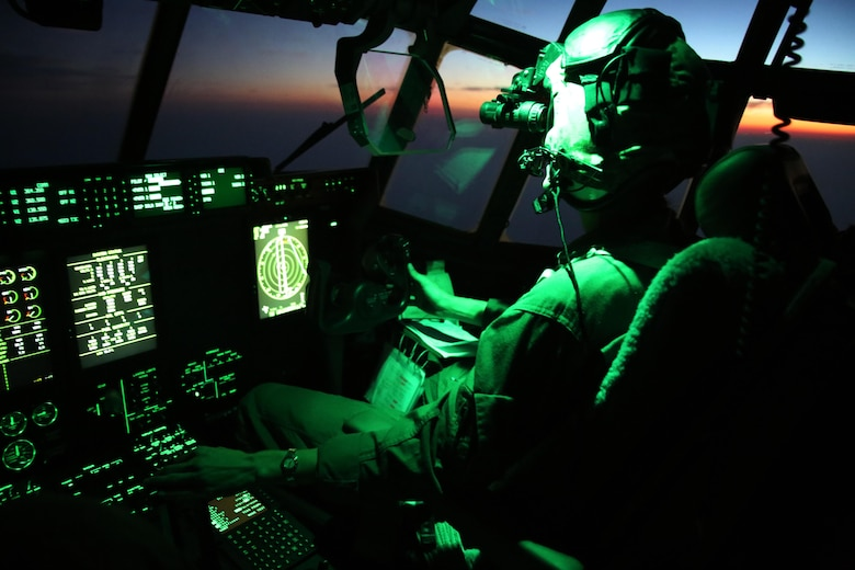 Maj. Janine Garner pilots a KC-130J Super Hercules with Marine Aerial Refueler Transport Squadron 252 during an aerial refueling mission over the Atlantic Ocean Sept. 7, 2016. The mission of VMGR-252 is to support the Marine Air Ground Task Force commander by providing air-to-air refueling, assault support, and offensive air support, day or night under all weather conditions during expeditionary, joint, or combined operations.  The squadron conducts aerial refuels for AV-8B Prowlers, EA-6B Harriers, and F-35B Lightnings off the coast of North Carolina to provide routine training for both the pilots and crew members. Garner is a KC-130 aircraft commander with MAG-14. (U.S. Marine Corps Photo by Lance Cpl. Mackenzie Gibson/Released)