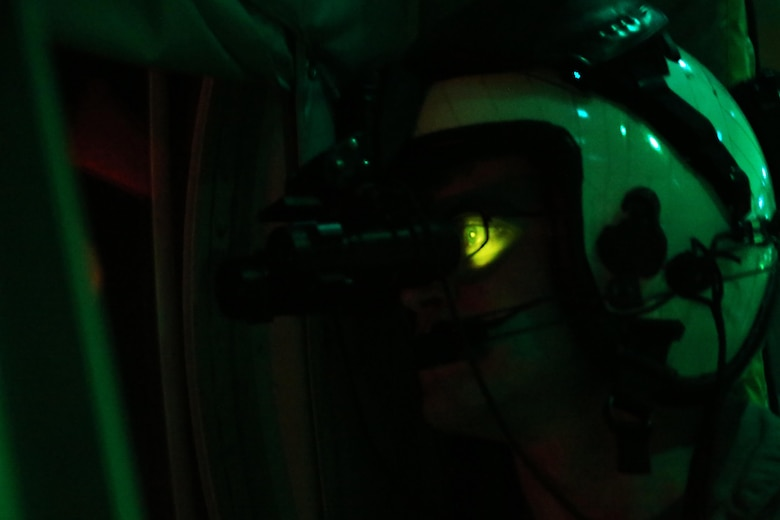 Lance Cpl. Jonathan Landis gazes through the window a KC-130J Super Hercules while wearing night vision goggles during an aerial refueling mission over the Atlantic Ocean Sept. 7, 2016. The mission of Marine Aerial Refueler Transport Squadron 252 is to support the Marine Air Ground Task Force commander by providing air-to-air refueling, assault support, and offensive air support, day or night under all weather conditions during expeditionary, joint, or combined operations.  VMGR-252 conducted aerial refuels for AV-8B Prowlers, EA-6B Harriers, and F-35B Lightnings off the coast of North Carolina to provide routine training for both the pilots and crew members. Landis is a KC-130 crew master with VMGR-252. (U.S. Marine Corps Photo by Lance Cpl. Mackenzie Gibson/Released)