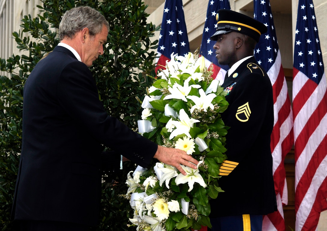 President George W. Bush lays a wreath at the crash site of American Airlines Flight 77 at the Pentagon on the fifth anniversary of the 9/11 terrorist attacks, Sept. 11, 2006. DoD photo by Air Force Staff Sgt. D. Myles Cullen