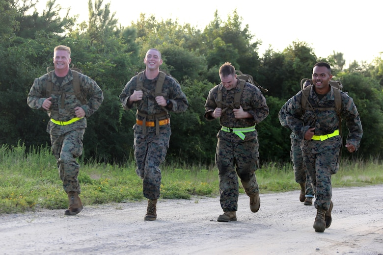 Marines assigned to Marine Tactical Air Command Squadron 28 run to their next station during their second annual Warrior Day at Marine Corps Air Station Cherry Point, N.C., Sept. 1, 2016. More than 50 Marines participated in MTACS-28's warrior day which included six different stations that incorporated ground fighting matches, an M-16 service rifle disassembly and reassembly, kayaking, radio set-up, repelling, and a 50-yard Humvee pull. Marines worked hand-in-hand to complete events as a team while sharing diverse leadership styles, years of experience and espirit de Corps. MTACS-28 is part of Marine Air Control Group 28, 2nd Marine Aircraft Wing. (U.S. Marine Corps photo by Cpl. Jason Jimenez/Released)