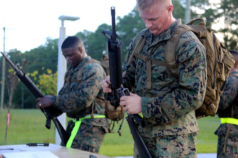 Gunnery Sgt. Nathan Sparks, left, and Maj. Robert Walker reassemble an M-16 assault rifle during Marine Tactical Air Command Squadron 28's second annual Warrior Day at Marine Corps Air Station Cherry Point, N.C., Sept. 1, 2016. More than 50 Marines participated in MTACS-28's warrior day which included six different stations that incorporated ground fighting matches, an M-16 service rifle disassembly and reassembly, kayaking, radio set-up, repelling, and a 50-yard Humvee pull. Marines worked hand-in-hand to complete events as a team while sharing diverse leadership styles, years of experience and espirit de Corps. MTACS-28 is part of Marine Air Control Group 28, 2nd Marine Aircraft Wing. (U.S. Marine Corps photo by Cpl. Jason Jimenez/Released)