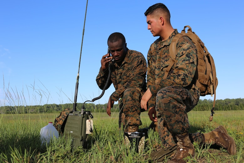 Cpl. Patrick Dean, left, and Pfc. Juan Diaz-Valenzuela conduct a radio check during Marine Tactical Air Command Squadron 28's second annual Warrior Day at Marine Corps Air Station Cherry Point, N.C., Sept. 1, 2016. More than 50 Marines participated in MTACS-28's warrior day which included six different stations that incorporated ground fighting matches, an M-16 service rifle disassembly and reassembly, kayaking, radio set-up, repelling, and a 50-yard Humvee pull. Marines worked hand-in-hand to complete events as a team while sharing diverse leadership styles, years of experience and espirit de Corps. MTACS-28 is part of Marine Air Control Group 28, 2nd Marine Aircraft Wing. (U.S. Marine Corps photo by Cpl. Jason Jimenez/Released)