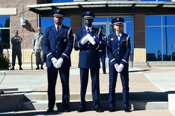 Mile High Honor Guard members stand as they wait to raise the American flag during a Patriot Day ceremony Sept. 9, 2016, on Buckley Air Force Base, Colo. Patriot Day, recognized by U.S. law as an official day of remembrance, has been observed every year since Sept. 11, 2001, and its tragic events. (U.S. Air Force photo by Airman 1st Class Gabrielle Spradling/Released)