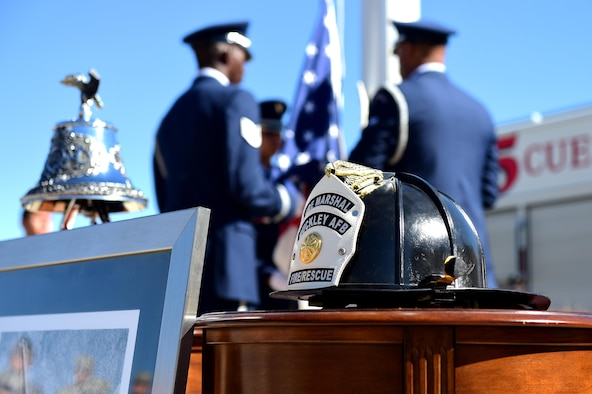 A Buckley Air Force Base firefighter helmet is displayed during a Patriot Day ceremony Sept. 9, 2016, on Buckley AFB, Colo. Patriot Day serves as a day of remembrance for the nearly 3,000 men, women and children that lost their lives during the terrorist attacks on Sept. 11, 2001. (U.S. Air Force photo by Airman 1st Class Gabrielle Spradling/Released)