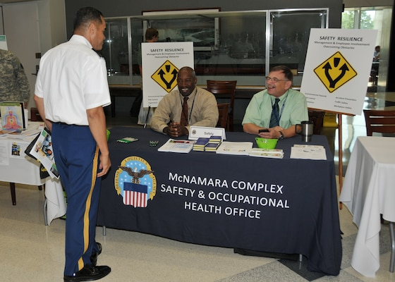 Army Command Sgt. Maj. Charles Tobin visits the McNamara Headquarters Complex Safety and Occupational Health table during the exhibits portion of DLA's Resiliency Day Sept. 7.