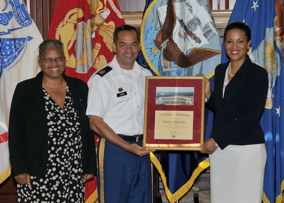 DLA Chief of Staff Renee Roman and Army Command Sgt. Maj. Charles Tobin present Michelle Millben a token of appreciation for her speech during DLA's Resiliency Day Sept. 7.