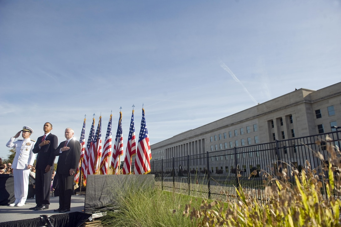 Navy Adm. Mike Mullen, left, chairman of the Joint Chiefs of Staff, President Barack Obama and Defense Secretary Robert M. Gates salute during the playing of the national anthem at the Pentagon Memorial during a Sept. 11, 2010, ceremony marking the ninth anniversary of the 9/11 terrorist attacks. DoD photo by Cherie Cullen