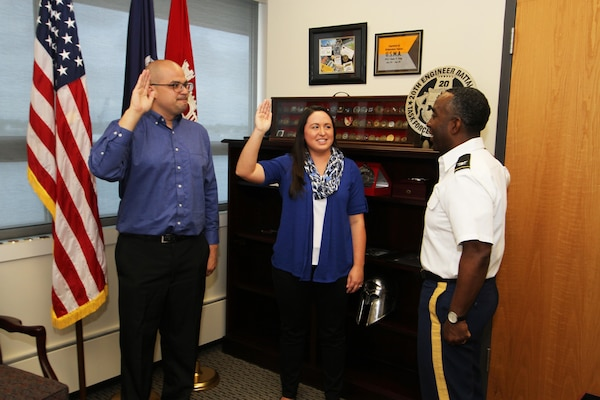 Norberto Quinones, a pathways intern from Binghamton University,  and Brittany Dunn, a pathways intern from Christopher Newport University, are sworn into federal service by Col. Jason Kelly, Norfolk District commander in his office in Norfolk, Virginia. The Pathways program offers three types of internship opportunities to individuals who are just starting out in their potential federal careers: the Internship Program, Recent Graduates Program and Presidential Management Fellows Program. (U.S. Army photo/Patrick Bloodgood)