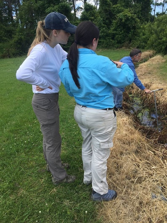 Carly Golden (left), a pathways intern from Brandeis University, an Brittany Dunn, a pathways intern from Christopher Newport University, discuss their observations during a field visit for a jurisdictional determination in Northampton County, Va.  The Pathways program offers three types of internship opportunities to individuals who are just starting out in their potential federal careers: the Internship Program, Recent Graduates Program and Presidential Management Fellows Program
