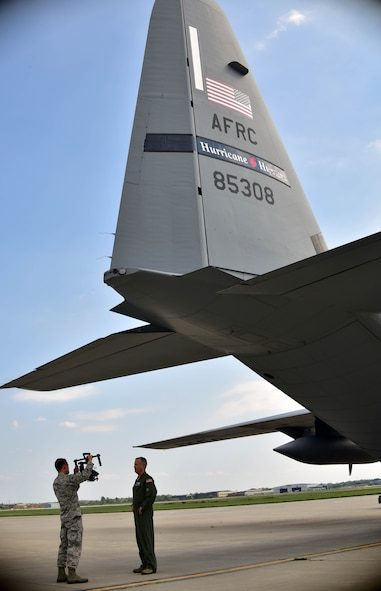 914th Airlift Wing Commander, Col. Brian S. Bowman, is interviewed by Senior Airman Joshua Williams, 914th Airlift Wing Public Affairs Broadcaster, on Tuesday, September 6, 2016 in front of a WC-130J from Keesler Air Force Base, Mississippi. The aircraft, part of the 53rd Weather Reconnaissance Squadron's Hurricane Hunters unit, was one of four planes utilizing Niagara's air field due to its location to Hurricane Hermine. The plane was able to receive necessary maintenance and fuel and crew members were able to receive lodging and rest allowing them to focus on their mission of monitoring and measuring Hurricane Hermine.