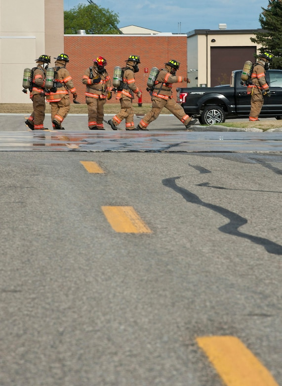 Firefighters with the 5th Civil Engineer Squadron contain a simulated fuel spill during a training exercise at Minot Air Force Base, N.D., Sept. 8, 2016. The firefighters contained the fuel while approximately 3,500 gallons of fuel was sucked up by the 5th Logistics Readiness Squadron's Petroleum, Oils and Lubricants department during the annual training. (U.S. Air Force photo/Airman 1st Class Jonathan McElderry)